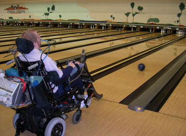 Power Wheelchair User Bowling With IKAN Bowler